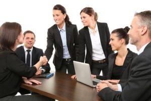 employees shake hands